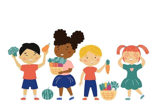 Enfants heureux avec des légumes et des fruits