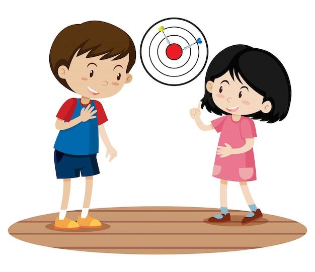 Enfants jouant au jeu de fléchettes