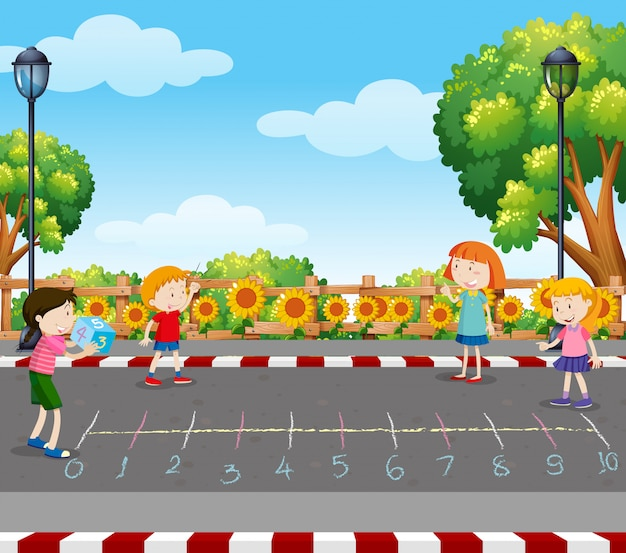 Enfants jouent au jeu de dés au parc