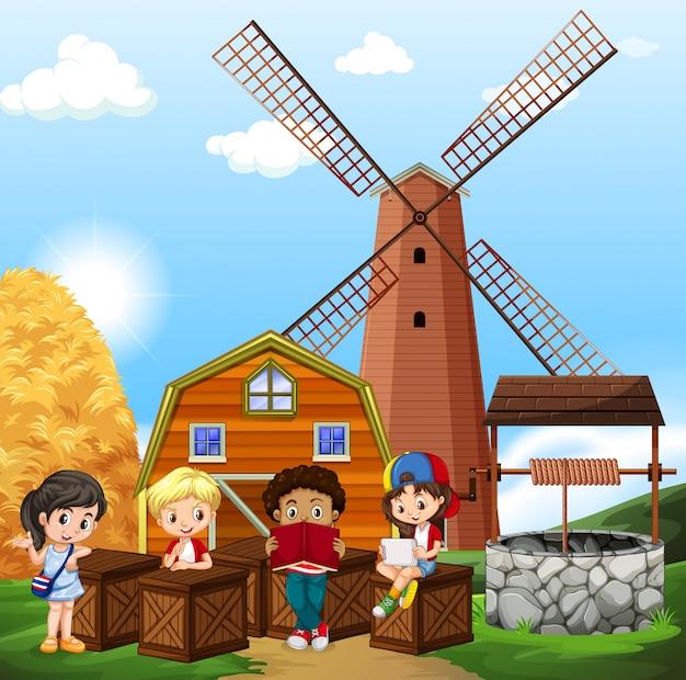 Enfants lisant à la ferme