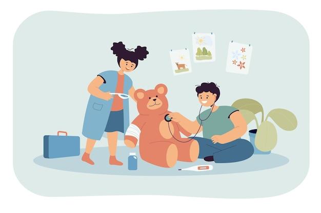 Enfants mignons jouant au docteur ensemble
