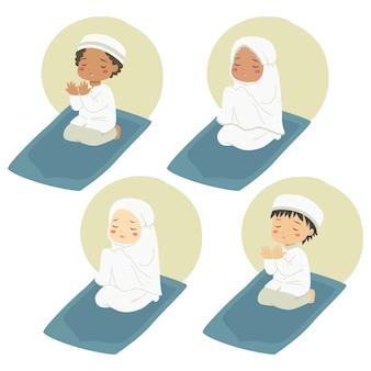 Enfants musulmans assis sur un tapis de prière et priant, jeu de caractères