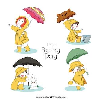 Enfants personnages avec des parapluies pour un jour de pluie