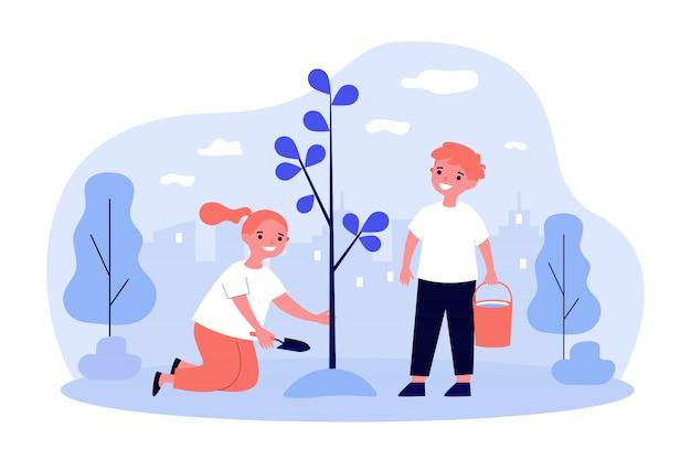 Enfants plantant un arbre au printemps