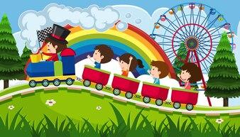 Enfants qui montent un train dans le parc d'attractions