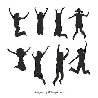 Enfants silhouettes sauter pack vecteur