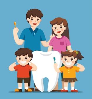Enfants souriants avec des parents debout à côté d'une grosse dent blanche. ils tiennent une brosse à dents montrant une dent saine et propre. hygiène et soins.