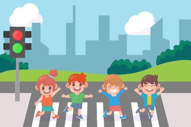 Enfants traversant le carrefour de la ville avec des feux de circulation