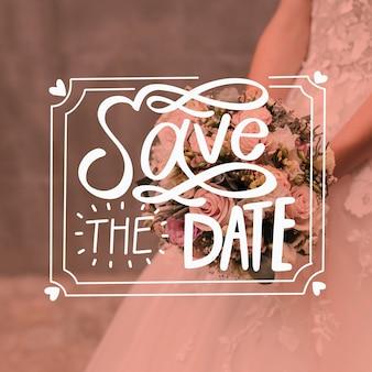 Enregistrez le lettrage de date avec la mariée et le bouquet