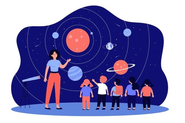 Enseignant avec des enfants au planétarium