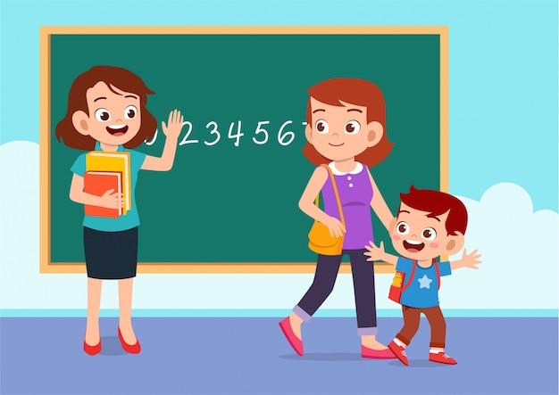 Enseignant, mère et garçon à l'école