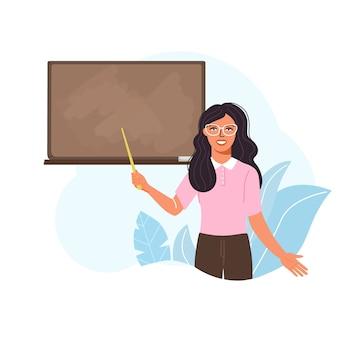 Enseignante enseigner au tableau noir en classe.
