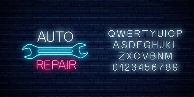 Enseigne d'atelier de réparation automobile au néon avec alphabet. symbole publicitaire de nuit rougeoyante de la station de réparation de véhicules.