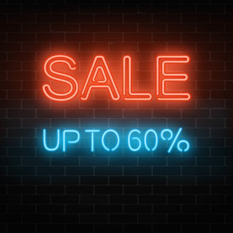 Enseigne au néon lumineux grande vente. invitation avec remise jusqu'à soixante pour cent.
