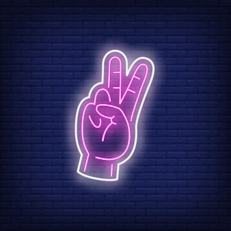 Enseigne au néon rose geste de paix