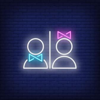 Enseigne au néon de toilettes homme et femme