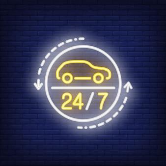 Enseigne au néon de vingt-quatre heures sur un atelier de réparation automobile