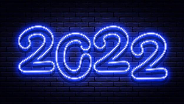 Enseigne néon bleu brillant de nouvel an sur le mur de briques.