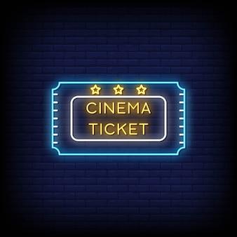 Enseigne néon cinema ticket sur mur de briques