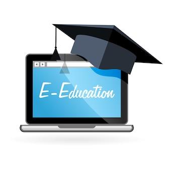 Enseignement à distance - ordinateur portable et chapeau académique, e-éducation