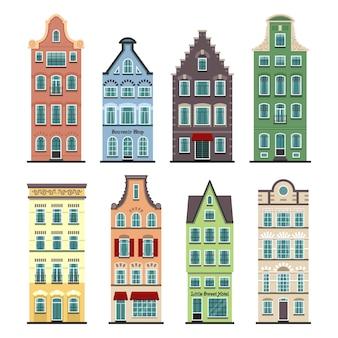 Ensemble de 8 façades de dessin animé de maisons anciennes d'amsterdam. architecture traditionnelle des pays-bas.