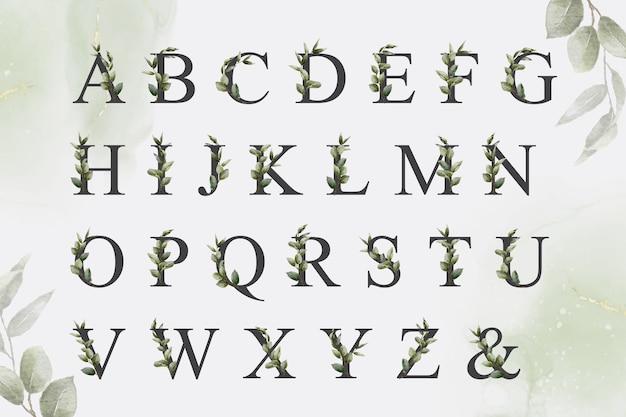 Ensemble d'alphabet floral aquarelle verdure avec des feuilles dessinées à la main