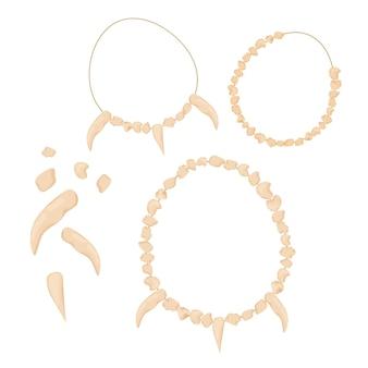 Ensemble d'amulette de bijoux d'âge de pierre des dents d'os d'isolement sur le blanc