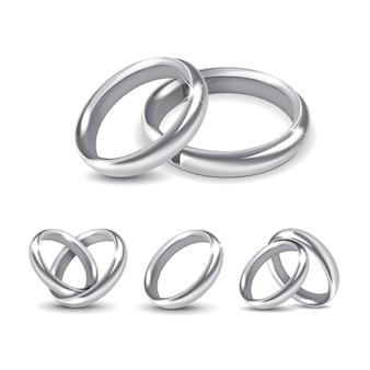 Ensemble d'anneaux de mariage en argent isolé sur blanc