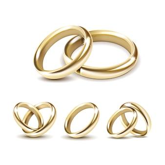 Ensemble d'anneaux de mariage or isolé sur blanc