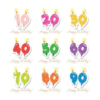 Ensemble d'anniversaire. bougies chiffres colorés de 10 à 90.