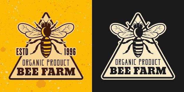 Ensemble d'apiculture et de miel de deux styles vectoriels emblème, insigne, étiquette ou logo sur fond jaune et foncé