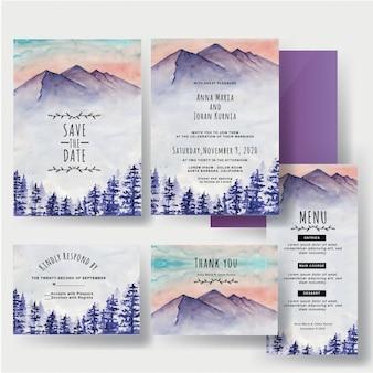 Un ensemble d'aquarelles invitations de mariage montagne hivernale et pin