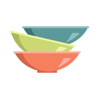 Un ensemble d'assiettes multicolores superposées. pile de bols vides, assiettes à soupe