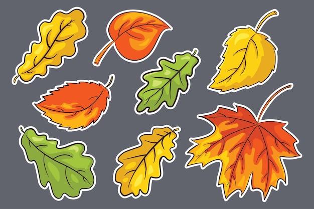 Ensemble d'autocollants de feuilles d'automne dessinés à la main. collection de feuillage forestier. feuille de chêne, d'érable et de noisetier. éléments décoratifs d'automne pour la conception et la décoration d'impression, d'invitation et de cartes de voeux. vecteur premium