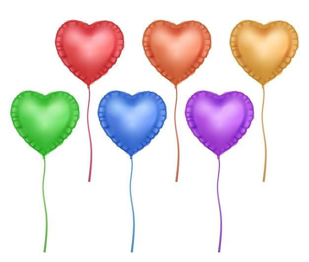 Ensemble de ballons en forme de coeur coloré lumineux isolé