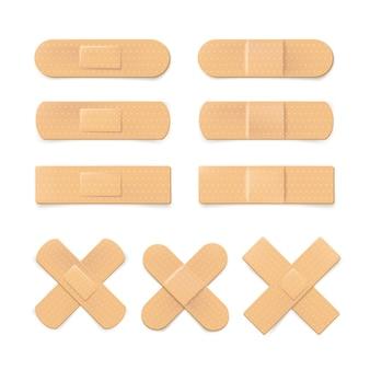 Ensemble de bandage en plâtre réaliste isolé sur blanc