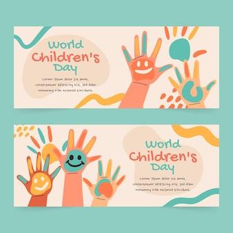 Ensemble de bannières horizontales pour la journée des enfants du monde plat dessinés à la main