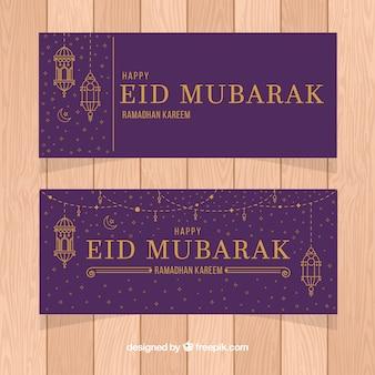 Ensemble de bannières de ramadan avec des lampes d'or en monolines