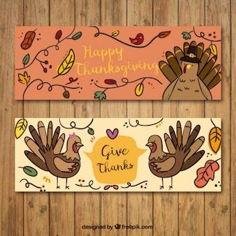 Ensemble de bannières thanksgiving avec des dindes et de la végétation