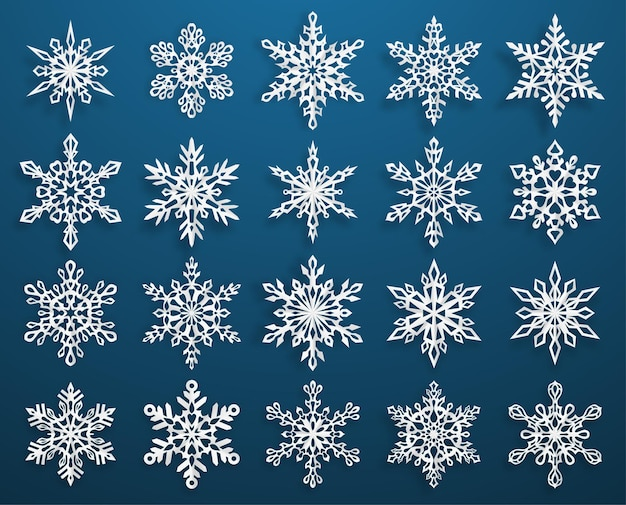 Ensemble de beaux flocons de neige de noël en papier complexe avec des ombres douces, blanc sur fond bleu