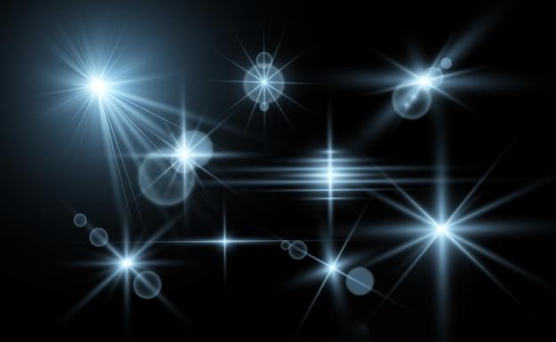 Ensemble de belles étoiles brillantes. effet lumineux. étoile brillante. belle lumière pour illustrer. étoile. des paillettes blanches scintillent avec un effet de lumière spécial. scintille sur un fond transparent.