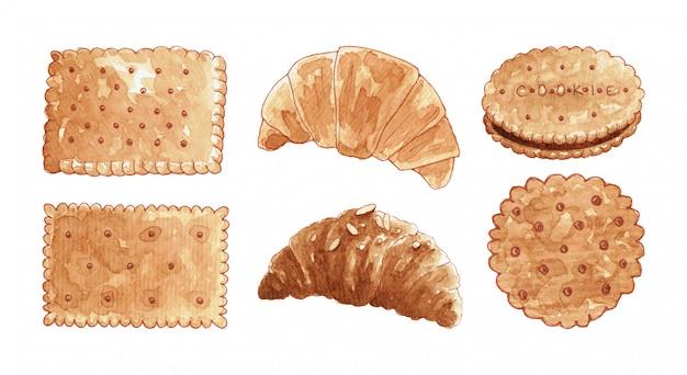 Ensemble de biscuits et croissants dessinés à la main à l'aquarelle.