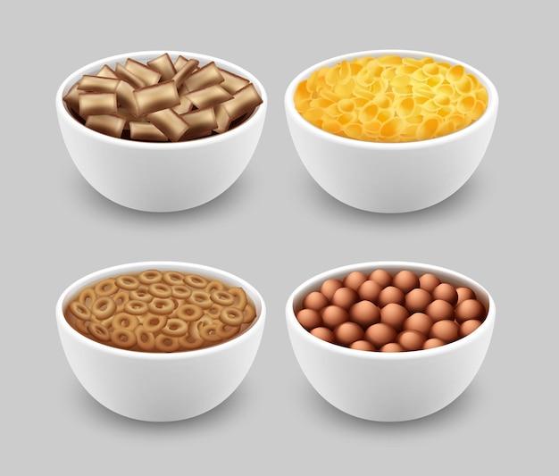 Ensemble de bols avec des coussinets de maïs anneaux boules et cornflakes isolés sur fond gris