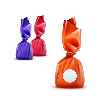 Ensemble de bonbons au chocolat réalistes dans un emballage