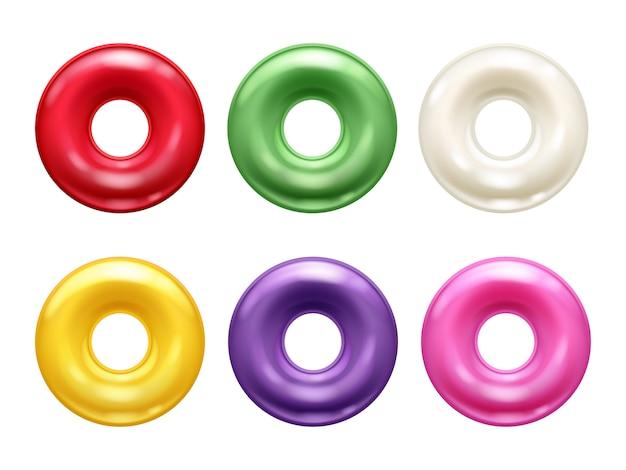 Ensemble de bonbons durs colorés ronds.