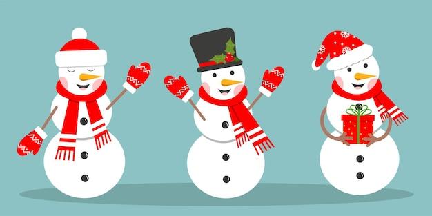 Ensemble de bonhomme de neige heureux dans des mitaines et une écharpe de chapeau