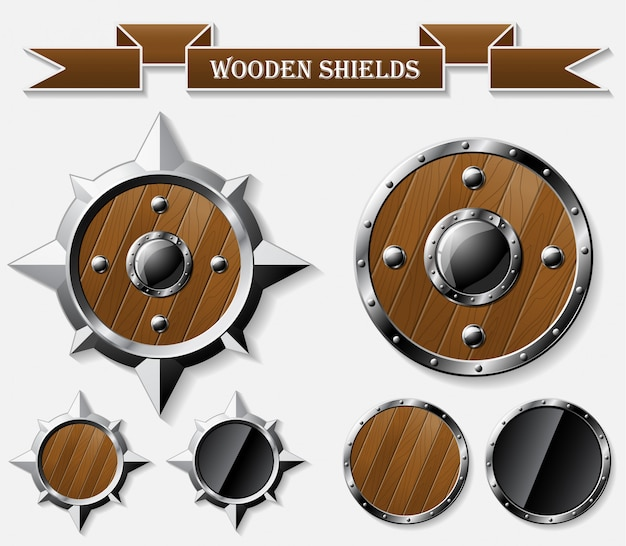 Ensemble de boucliers en bois réalistes isolés sur gris