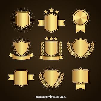 Ensemble de boucliers d'or élégantes