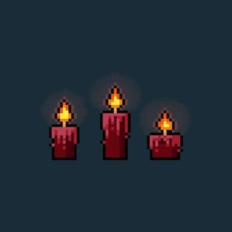 Ensemble de bougies rougeoyantes de dessin animé rouge pixel art.