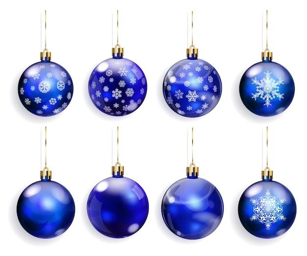 Ensemble de boules de noël bleues avec des flocons de neige